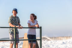 Teenagers Girl Boy Talking Tidal Pool Ocean Waves Royalty Free Stock Images