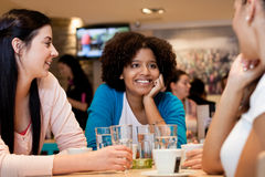 Teenagers girls in cafe Stock Photos