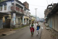 Teenagers go to school in Puthia, Bangladesh. PUTHIA, BANGLADESH - FEBRUARY 16, 2014: Unidentified teenagers go to school on February 16, 2014 in Puthia Royalty Free Stock Photography