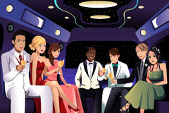 Teenagers going to a prom party in a limousine Stock Photo