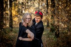 Teenagers in Halloween costumes in the woods royalty free stock photography