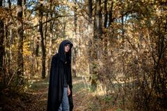 Teenagers in Halloween costumes in the woods. Halloween vampire in the woods royalty free stock images