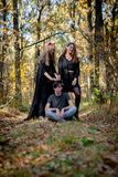 Teenagers in Halloween costumes in the woods royalty free stock photo