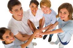 Teenagers with hands together Stock Photos