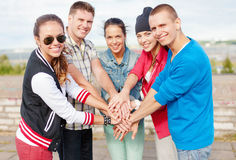 Teenagers hands on top of each other outdoors Royalty Free Stock Photo