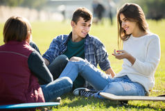Teenagers hanging out outdoors and discussing something Royalty Free Stock Photo