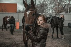 Teenagers harness village horses for agricultural work