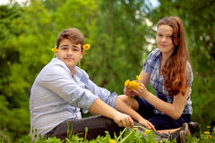 Teenagers have fun in the park, playing guitar, singing son Stock Images