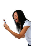 Teenagers have fun with SMS message. Young woman has fun with SMS message Royalty Free Stock Image