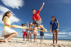 Teenagers having fun on beach. Teenagers having fun in the sun on a beach stock photo