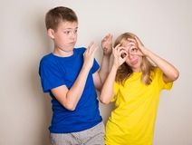 Teenagers having fun. Boy and girl making funny faces grimace. People, friends, teens and friendship concept stock photography