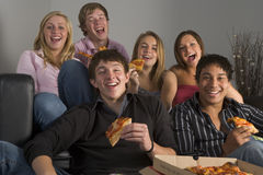 Teenagers Having Fun And Eating Pizza.  Royalty Free Stock Images