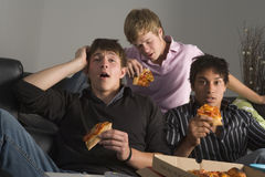 Teenagers Having Fun And Eating Pizza.  Royalty Free Stock Photography