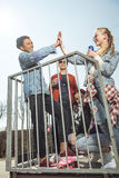 Teenagers having fun and giving highfive in skateboard park Stock Photo