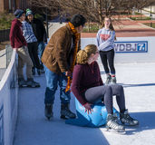 Teenagers Having Fun on the Ice Royalty Free Stock Photo