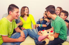 Teenagers having fun indoor. Teenagers having fun at home Royalty Free Stock Photography