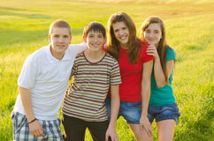 Teenagers having fun on the meadow Stock Photography