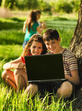 Teenagers having fun in the nature. On sunny spring day Royalty Free Stock Photography