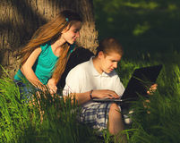 Teenagers having fun in the nature. On sunny spring day Royalty Free Stock Image