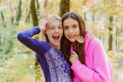 Free Teenagers Having Fun On Autumn Background. Two Surprise Woman Playing With Leaves And Looking At Camera. Happy Young Royalty Free Stock Images - 129213849