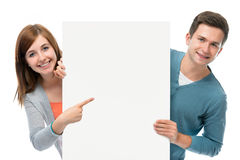 Teenagers holding at a blank board Royalty Free Stock Photography