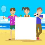 Teenagers holding blank board at beach. Teenager boys and girl standing with sports equipment holding a blank board at the beach Stock Photo