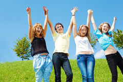 Teenagers holding hands Royalty Free Stock Photography