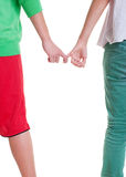 Teenagers holding hands against white background. Photo of teenagers holding hands against white background Royalty Free Stock Photo