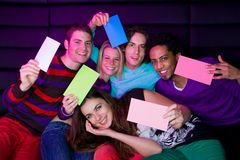 Teenagers holding signs Royalty Free Stock Photography