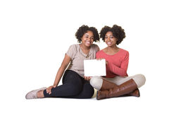 Teenagers holding a tablet. Isolated on white Stock Photography