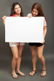 Teenagers holding a white sign Stock Photo