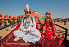 Teenagers in Indian folk costumes sitting Stock Photos