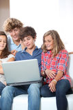 Teenagers and internet Stock Photography