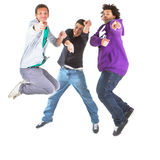 Teenagers jumping in joy. Three multiracial teenagers jumping over joy over white background Stock Photos