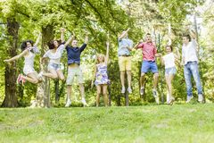 Teenagers jumps in the park Royalty Free Stock Photo