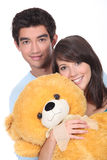 Teenagers with a large teddy Stock Image