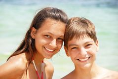 Teenagers laughing on seaside Stock Photo