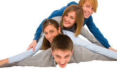 Teenagers laying in pile. Isolated on white background Stock Images