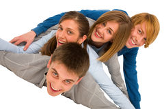 Teenagers laying in pile Royalty Free Stock Photo