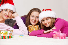 Teenagers lie on floor Stock Photography