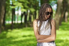 Teenagers Lifestyle Concepts. Young African American Teenager Girl With Plenty of Long Dreadlocks. Posing in Sunglasses Outdoors.Horizontal Composition stock photography