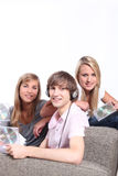 Teenagers listening to CDs Royalty Free Stock Image