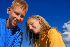 Teenagers listening to music Stock Images
