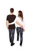Teenagers in love, boy and girl hugging and walking. Rear view. Isolated on white background Royalty Free Stock Photos