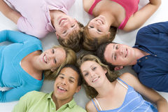Teenagers Lying Down Head To Head stock images