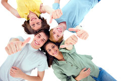 Teenagers lying down with thumbs up Royalty Free Stock Photography