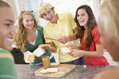 Teenagers Making Sandwiches Royalty Free Stock Image