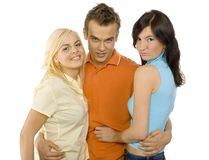 Teenagers - man and two women Royalty Free Stock Photos