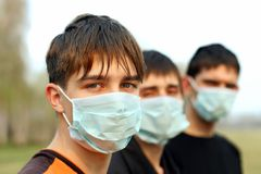Teenagers in mask. Three teenagers in the mask outdoor Royalty Free Stock Images