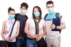 Teenagers with masks for protection Royalty Free Stock Photos